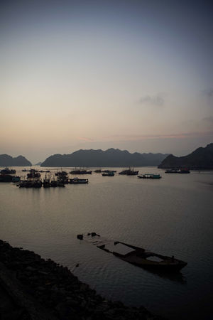 traveling Vietnam 2018 ASIA Travel Traveling Vietnam Beauty In Nature Explore Idyllic Mode Of Transportation Mountain Mountain Range Nature Nautical Vessel No People Outdoors Reflection Scenics - Nature Sea Silhouette Sky Sunset Tranquil Scene Tranquility Transportation Water
