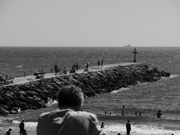 Thinking Beach Black And White Blackandwhite Clear Sky Day Group Of People Horizon Horizon Over Water Leisure Activity Men Outdoors People Real People Sea Sky Vacations Water