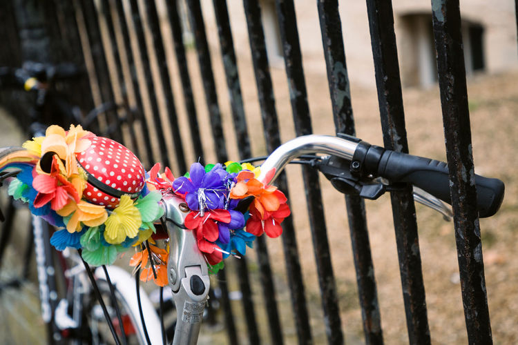 Colourfully decorated bike handlebars of a bike chained up against railings around Radcliffe Square in Oxford Colourful Handlebars Oxford Oxford Uni Oxford University Railing Bicycle Bicycle Rack Bike Bikes Close-up College College Life Day Flowers Focus On Foreground Handlebar Metal Multi Colored No People Outdoors Railings Stationary