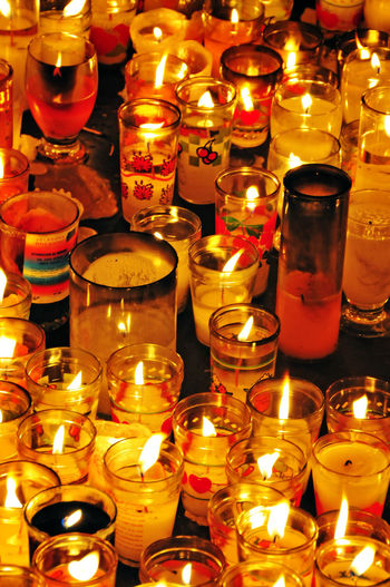 Candles in a Panajachel, Guatemala church Catholic Church Guatemala Abundance Altar Arrangement Belief Burning Candle Close-up Fire Fire - Natural Phenomenon Flame Glowing Heat - Temperature Illuminated Indoors  Large Group Of Objects No People Place Of Worship Religion Spirituality Tea Light