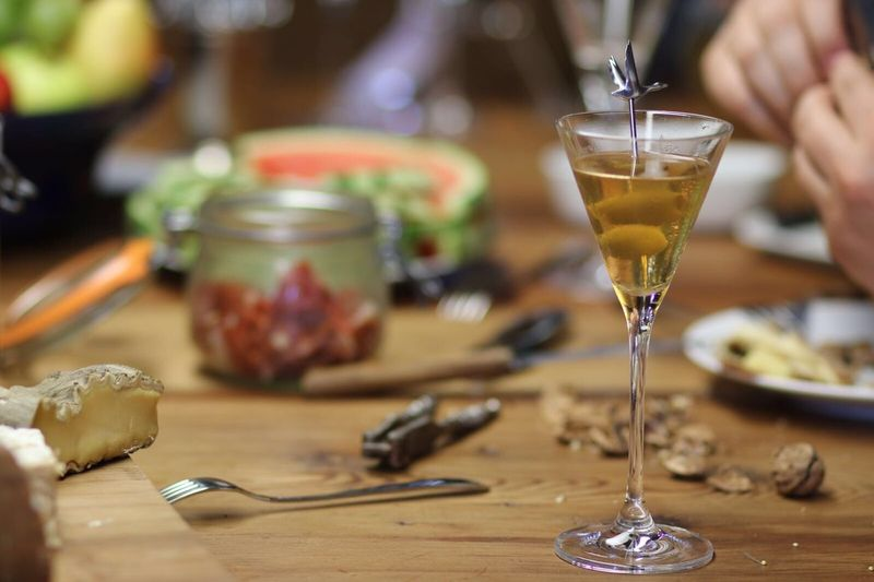 Close-Up Of Alcohol In Martini Glass On Table