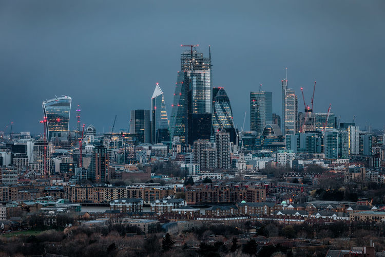 The skyline of the City of London during evening time with a storm approaching and dark clouds Building Exterior Built Structure Architecture City Cityscape Sky Building Office Building Exterior Skyscraper Urban Skyline Tall - High Modern Financial District  Tower Outdoors City Of London London Dark Evening Storm Weather Financial District  Finance Banking Lights Illuminated Cityscape Blue Grey Rain Brexit