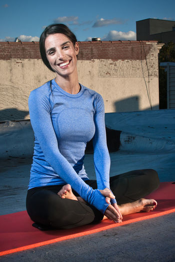 Athlete Athletics Bright Brooklyn Fitness Girl Mattress Pilates Real People Rooftop Sitting Smile Sport Sun Sunset Woman Yoga Young Adult