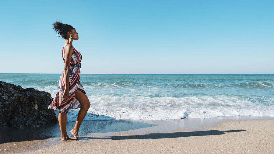 Sea Water Beach Horizon Land Full Length Horizon Over Water Sky One Person Beauty In Nature Nature Leisure Activity Lifestyles Vacations Trip Wave Holiday Day Hairstyle Hair Outdoors