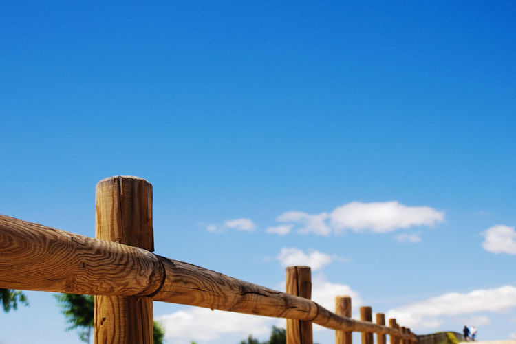 Beauty In Nature Blue Close-up Cloud Day Focus On Foreground Low Angle View Nature Outdoors Pole Railing Railing _ Collection Scenics Sky Tranquil Scene Tranquility Wood Wood - Material Wooden Wooden Post