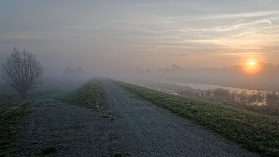 Misty running place Choice Different Directions Morning Sun Running Beauty In Nature Crossroad Fog Gravel Road Landscape Mist Misty Morning Nature No People Outdoors Road Running Track Scenics Sky Sunrise Sunrsie Sunset The Way Forward Tranquil Scene Tranquility Tree