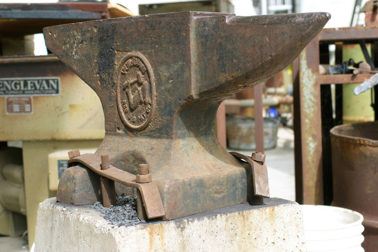 Close-up of rusty anvil in art school