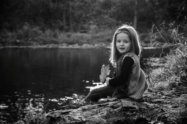 Lucky Leaf. One Girl Only One Person Outdoors Water Children Only People Day Nature Bnw_friday_eyeemchallenge Bnw_leaves Black And White Portrait Girl Child People In Places Photoshoot Childhood Monochrome Looking At Camera Sitting Innocence Blackandwhite Black & White Creek Backlight