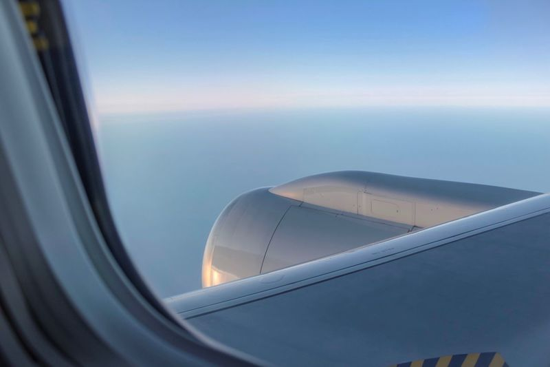 View of sea through airplane window