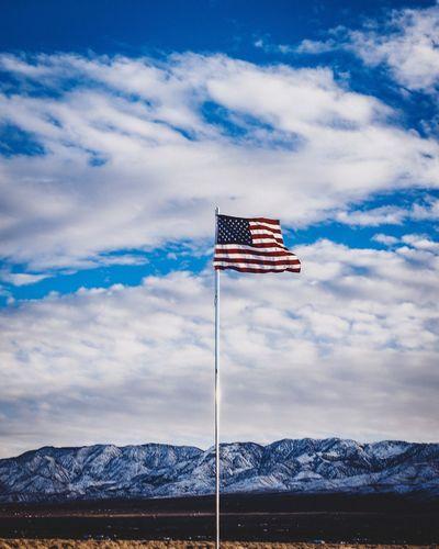 Flag on field against sky