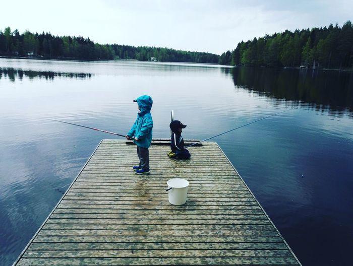 View of children fishing at lake