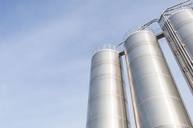 Industrial silos for chemical production, by stainless steel. Architecture Built Structure Chemical Close-up Compartment Day Factory Factory Building Industry Low Angle View Metal No People Outdoors Petrochemical Plant Silo Sky Storage Storage Tank