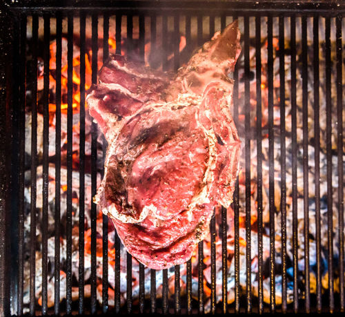 Grilling Big T-bone steak on natural charcoal barbecue grill. Preparing a big steak on natural firewood BBQ in outside fireplace. Chop Homemade Homemade Food Barbecue Barbecue Grill Beef Charcoal Delicious Flame Food Food And Drink Food Porn Freshness Grill Grilled Heat - Temperature Meat Preparing Stake T-bone T-bone Steak