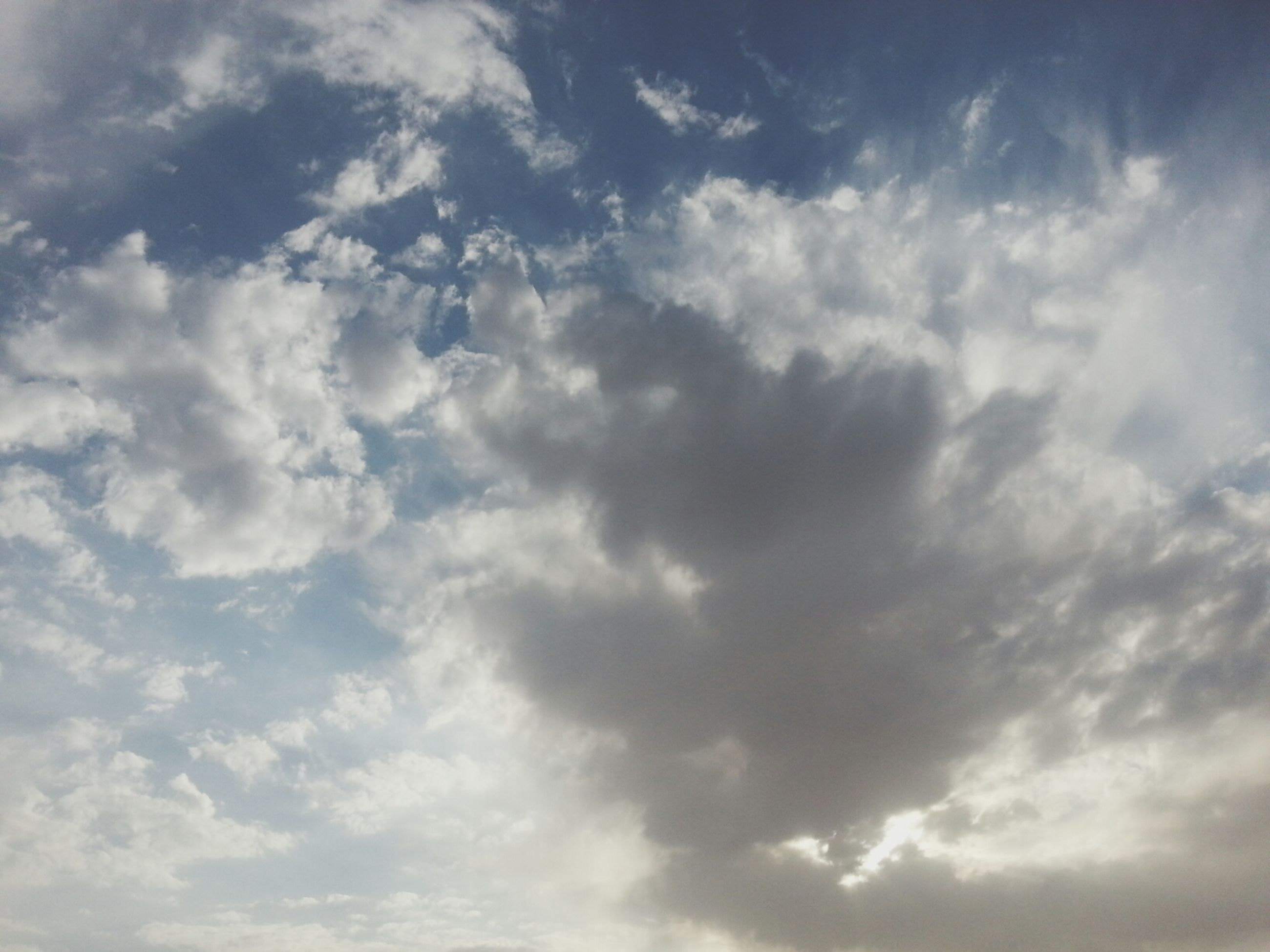 sky, cloud - sky, low angle view, cloudy, beauty in nature, tranquility, sky only, scenics, nature, tranquil scene, cloudscape, cloud, backgrounds, white color, weather, idyllic, full frame, day, outdoors, no people