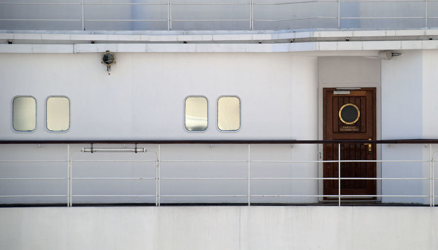 Closed wooden door with window on cruise ship