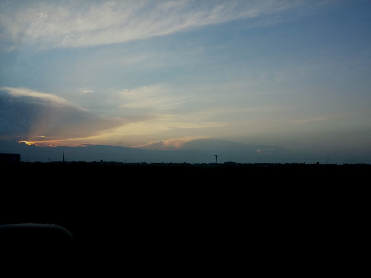 Silhouette View Of Landscape At Sunset