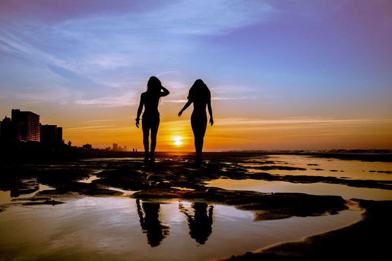 Sunrise Silhouette Sky Water Two People Reflection Silhouette Leisure Activity Real People Lifestyles Cloud - Sky Orange Color Women Sunset Sunrise Beauty In Nature Togetherness People Positive Emotion Outdoors Standing Beauty In Nature Ocean Purple Young Women
