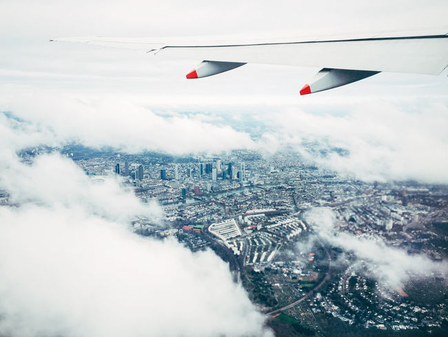 Frankfurt Am Main Transportation Travel Wing Adventure Aircraft Airplane Window Architecture Building Exterior Built Structure City Cityscape Cloud - Sky Clouds Day Flying Mid-air Nature No People Outdoors Red Sky
