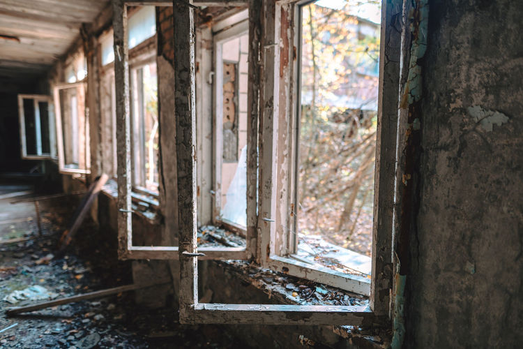 Interior of abandoned house with broken windows in chernobyl