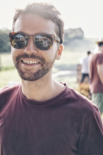 Portrait Of Man Wearing Sunglasses While Standing Outdoors