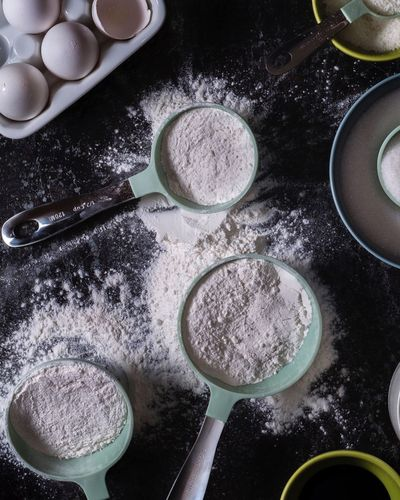 Flour. Baking. Preparation  Flour Indoors  Egg Food And Drink Dough High Angle View Batter Ingredient Bowl No People Mixing Bowl Food Freshness Raw Food Directly Above Domestic Room Baking Pan Mixing Close-up