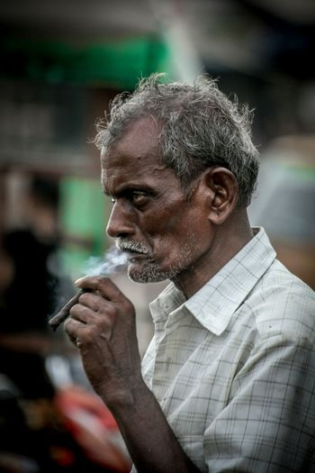 Gangs of Wassepur lll Portraits Of EyeEm People India Black Beedi Portrait Photography Men Gray Hair Headshot Males  Smoking - Activity Mature Men Bad Habit Addiction Drink Smoking Smoking Issues Cigarette  Cigar Tobacco Product Marijuana Joint Pipe - Smoking Pipe Thinking Unhealthy Living Moments Of Happiness