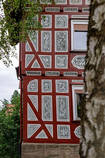 Altes Fachwerk Malerisches Handwerk Tree Plant Architecture Built Structure Day No People Nature Building Exterior Building Outdoors Pattern Entrance Art And Craft Craft Wood - Material Low Angle View Closed Religion Growth Door Ornate Ornamentic Element Altes Handwerk