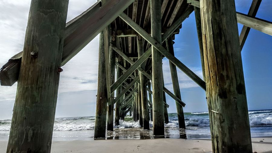 Below view of pier over beach