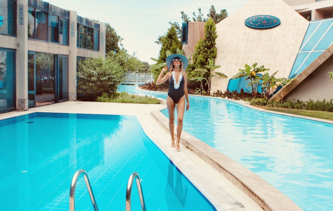 pool, swimming pool, water, lifestyles, one person, real people, swimwear, full length, young adult, leisure activity, poolside, nature, architecture, day, bikini, young women, built structure, turquoise colored, outdoors