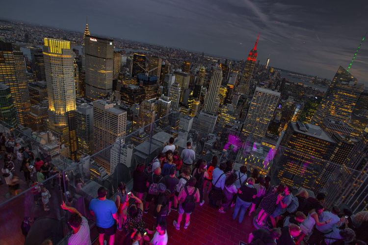 High angle view of crowd at illuminated building at night