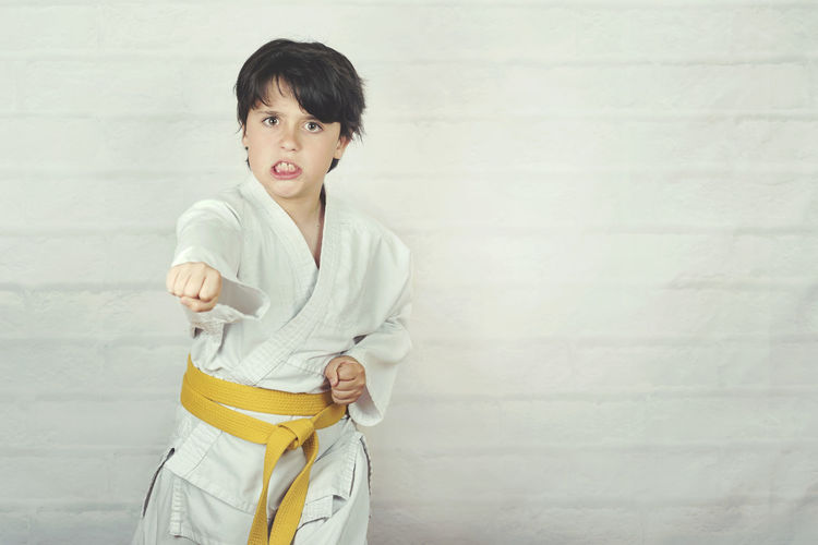 Portrait Child Childhood Karate KarateKid Karate Kid Attack Defense Sport Technique Strong Strength Judo Judoka Fight Fighting Fighter Kimono Fitness Expression Winner Combat Position Kickboxing Belt  Resistance  Athlete Success Taekwondo Kick Aïkido Healthy Martial Arts Practices Posture Power Strike Active Jujitsu Practice Punch Victory People Activity Pose Action Exercise Training Kid