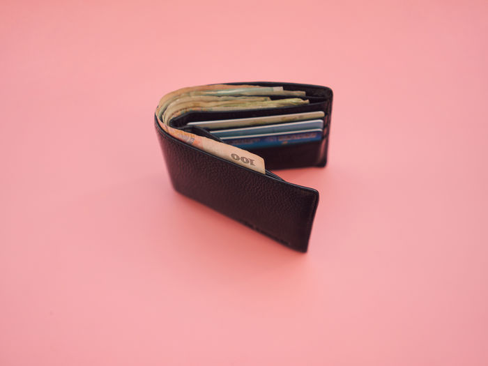 Bank Card Black Color Cash Close-up Copy Space Cut Out Focus On Foreground High Angle View Indoors  Money Pink Background Single Object Still Life Table Wallets