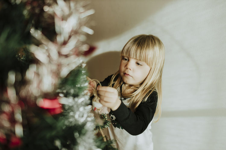 Girl looking at christmas tree
