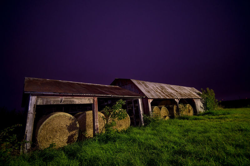 Night Landscape Hay Shed Side View Purple Sky Hay Barn Rich Abandoned Architecture Bales Building Exterior Built Structure Field Grass Hay Shed Nature Night Night Landscape No People Outdoors Purple Color Purple Sky Rich Colors Sky Tree