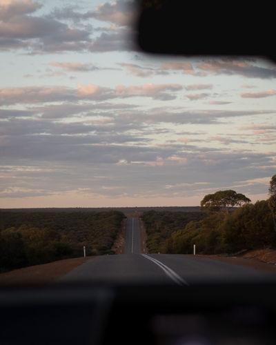 Road seen through car windshield