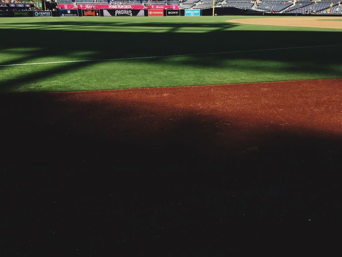 Baseball field and shadows before the game starts. Sport Grass No People Green Color Nature Track And Field Love The Game Illuminated Empty Sports Track Sky Playing Field Outdoors Built Structure Absence Night Team Sport Plant High Angle View Field 17.62°