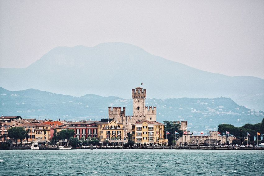 The romantic feeling when the trip has come to an end and your on the ferry saying goodbye. Landmark Fortress Scaligero Scaligero Castle Desenzano Del Garda History Lake Castle Architecture Building Exterior Built Structure Mountain Building City Travel Destinations Water History The Past Mountain Range Travel Waterfront Outdoors