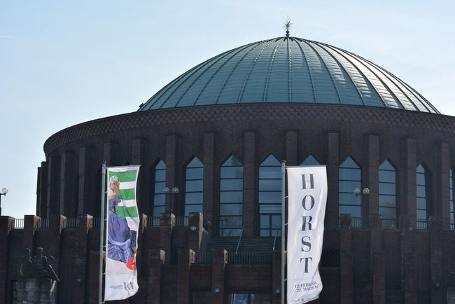 Tonhalle Düsseldorf , with the Copper  Roof and interesting backdrop for the Flags from NRW-Forum advertising the Horst Exhibition Horst P Horst , Photographer Of Style from V&A