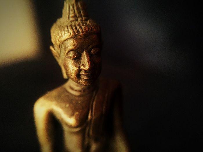 Close-up of metallic buddha statue