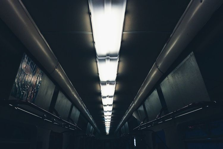 Low Angle View Of Illuminated Fluorescent Lights In Subway Train