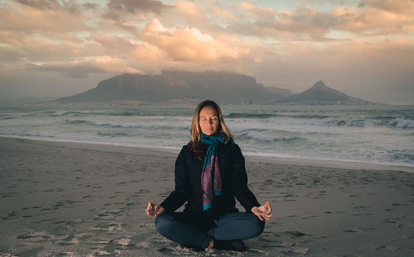 Beach Beauty In Nature Calm Cape Town Cape Town, South Africa Cloud Cloud - Sky Idyllic Lifestyles Meditate Meditation Mountain Namaste Outdoors Peace Portrait Relaxation Sea Sea And Sky Shore Sky Table Mountain Tranquil Scene Tranquility Woman
