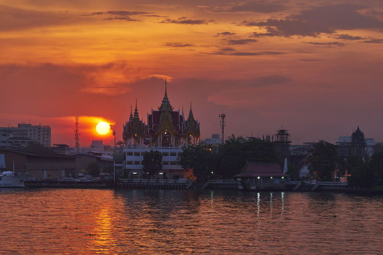 temple Temple Architecture Sunset_collection Culture And Tradition City Politics And Government Water Sunset Factory Industry Nautical Vessel Metal Industry Gold