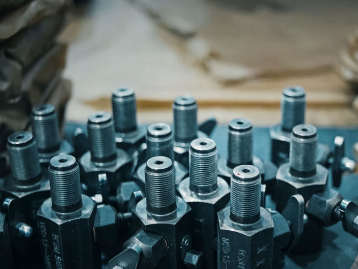Close-up of machine parts on table at factory