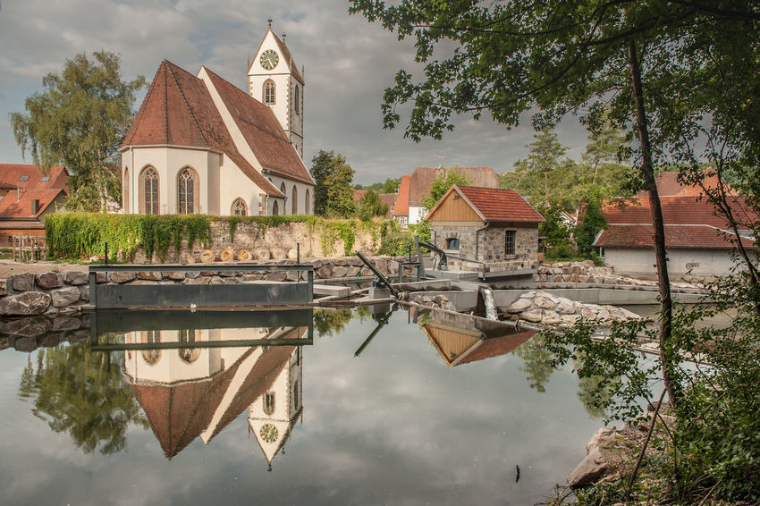 Architecture Building Exterior Built Structure Calm Church Cloud Cloud - Sky Day No People Outdoors Place Of Worship Pond Reflection Religion Scenics Sky Southern Germany Spirituality Standing Water Tranquil Scene Tranquility Tree Water Waterfront Weir