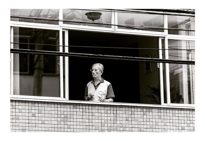 Window Adult Building Exterior People One Person Architecture Day The Photojournalist - 2017 EyeEm Awards Brazil Travel Destinations Salvador Bahia The Street Photographer - 2017 EyeEm Awards Streetphotography Urbanphotography Documentary Photography Editorial Use Only City Sad & Lonely NewEyeEmPhotographer Neweyeemhere Oldman Elderlypeople Blackandwhite Photography Architecture EyeEmNewHere