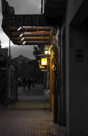 Man in illuminated corridor of building