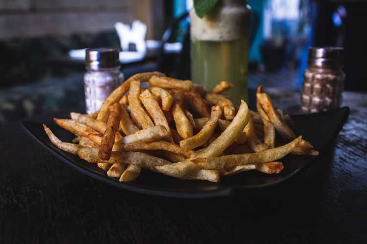French Fries Unhealthy Eating Ready-to-eat Fast Food Prepared Potato Fried Food And Drink Food Potato Table Deep Fried  Snack Still Life Indoors  Close-up Freshness Fast Food French Fries No People Condiment Plate Temptation Comfort Food Tray