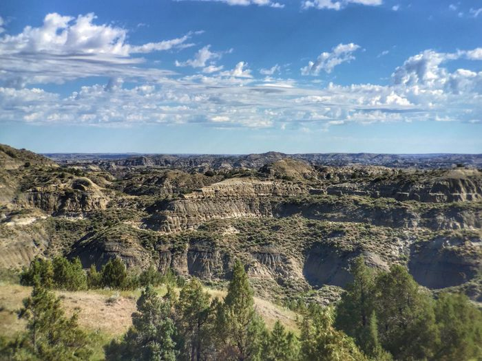 The Badlands of North Dakota at Theodore Roosevelt national Park Landscape Sky Nature Scenics Tranquil Scene Day Tranquility Outdoors Arid Climate Tree Mountain Physical Geography Beauty In Nature No People Cloud - Sky