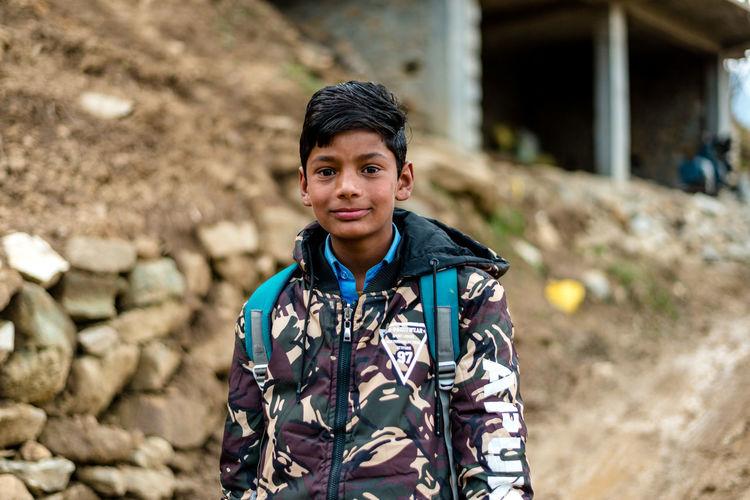 Portrait of boy standing outdoors