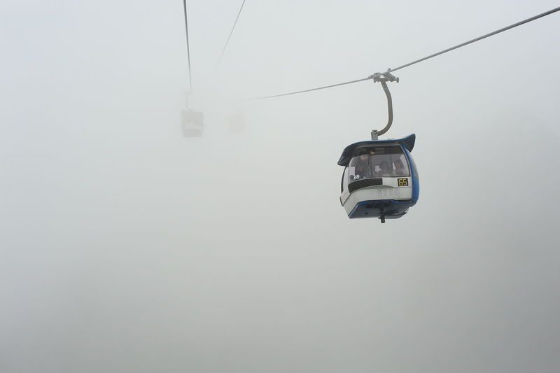 Genting Highland Malaysia Beauty In Nature Cable Cable Car Cold Temperature Day Fog Hanging Journey Mode Of Transportation Nature No People Outdoors Overhead Cable Car Scenics Ski Lift Sky Snow Transportation Travel Winter